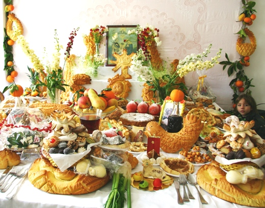 Table laden with breads & sweets in Sicily