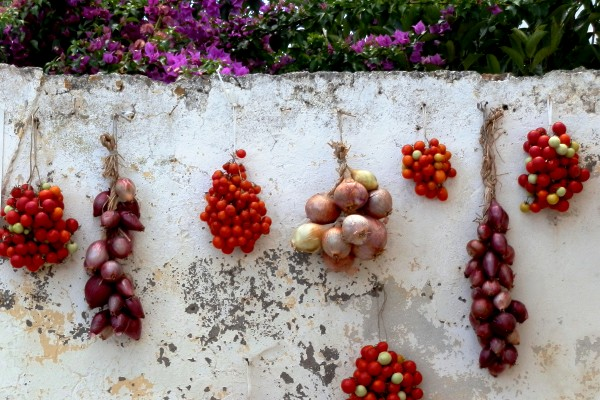 Hanging tomatoes and onions