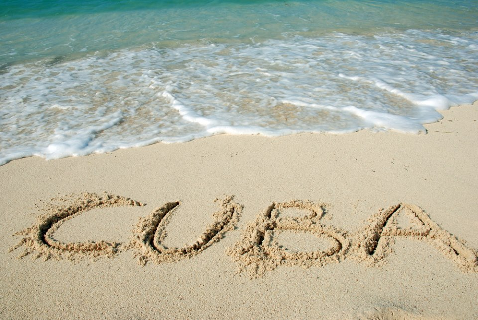 cu cuba written in sand